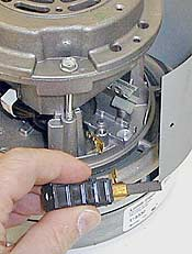 How to access and replace the motor brush on a central